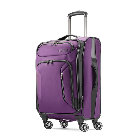 "American Tourister Zoom 21"" Spinner in the color Purple."