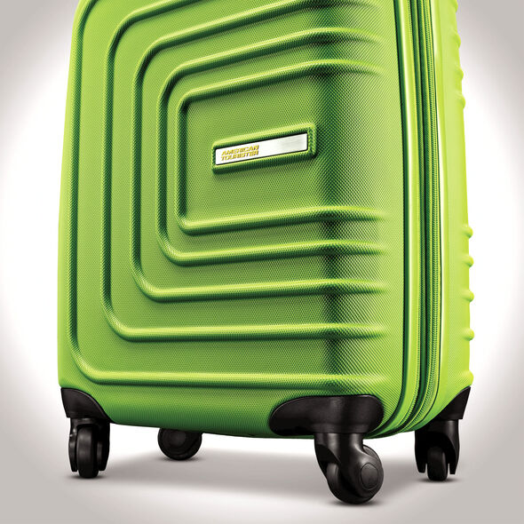 """American Tourister Sunset Cruise 20"""" Spinner in the color Apple Green."""