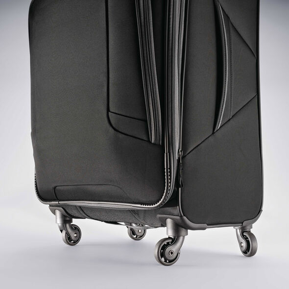 "American Tourister 4 Kix 21"" Spinner in the color Black/Grey."