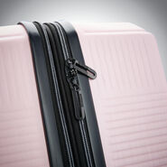 "American Tourister Stratum XLT 20"" Spinner in the color Petal Pink."
