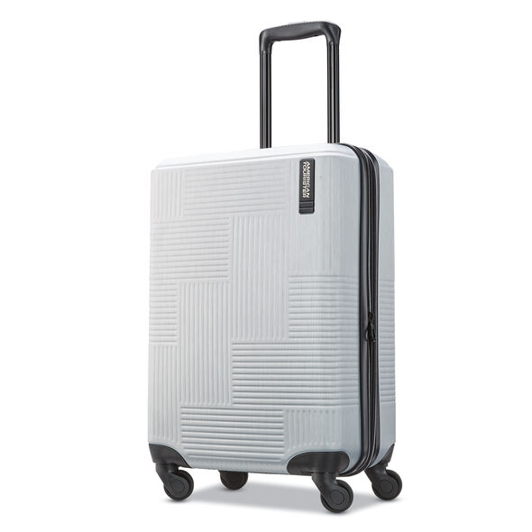 "American Tourister Stratum XLT 20"" Spinner in the color Brushed Silver."