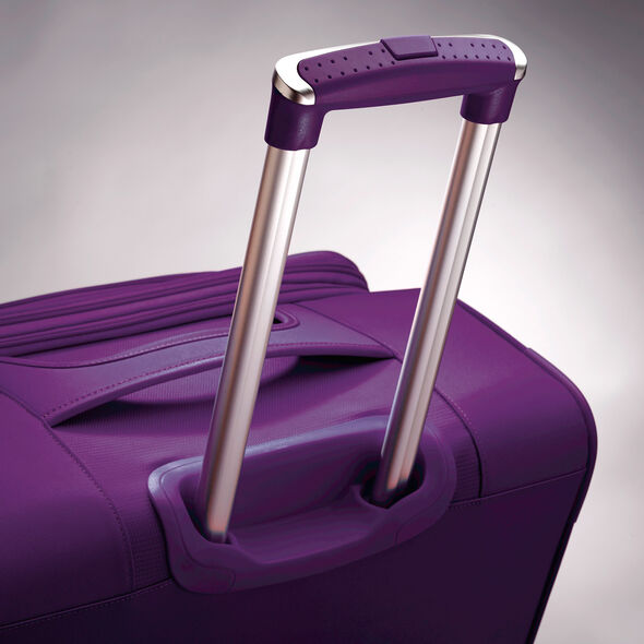 "American Tourister iLite Max 25"" Spinner in the color Purple."