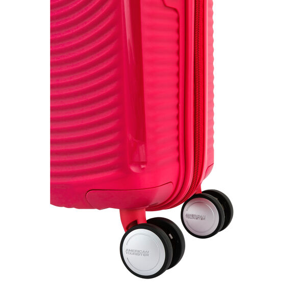 """American Tourister Curio 29"""" Spinner in the color Pink."""