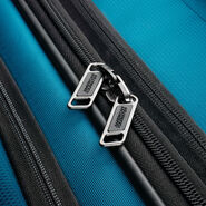 """American Tourister Zoom 21"""" Spinner in the color Teal Blue."""