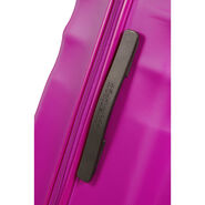 """American Tourister Wavebreaker 20"""" Spinner in the color Hot Lips Pink."""