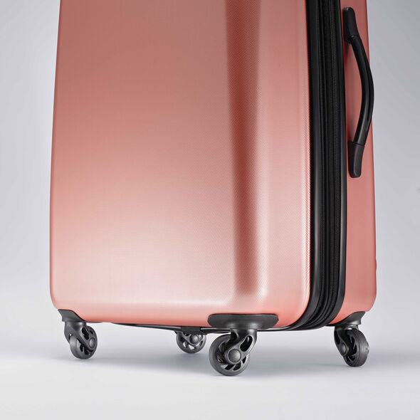 "American Tourister Moonlight 24"" Spinner in the color Rose Gold."