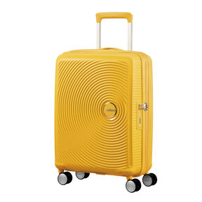 "American Tourister Curio 20"" Spinner in the color Golden Yellow."