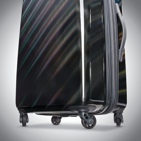 """American Tourister Moonlight 24"""" Spinner in the color Iridescent Black."""