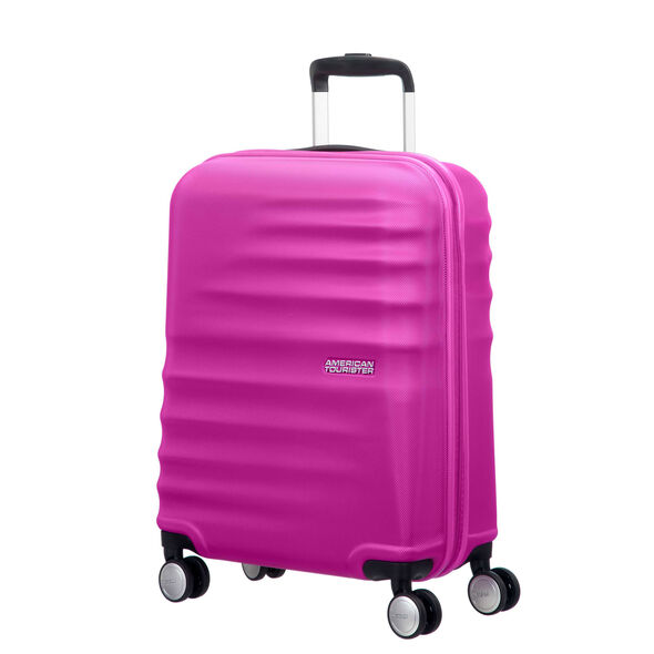 "American Tourister Wavebreaker 20"" Spinner in the color Hot Lips Pink."