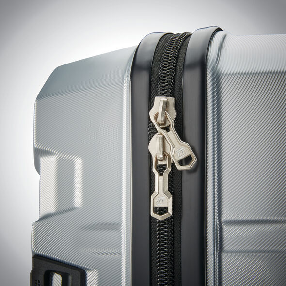 American Tourister Trip Locker Spinner Trunk in the color Silver.