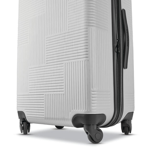 "American Tourister Stratum XLT 24"" Spinner in the color Brushed Silver."