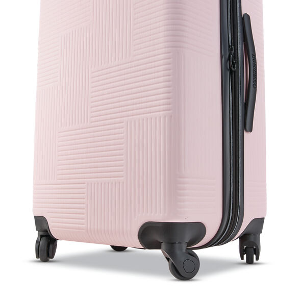 "American Tourister Stratum XLT 24"" Spinner in the color Petal Pink."