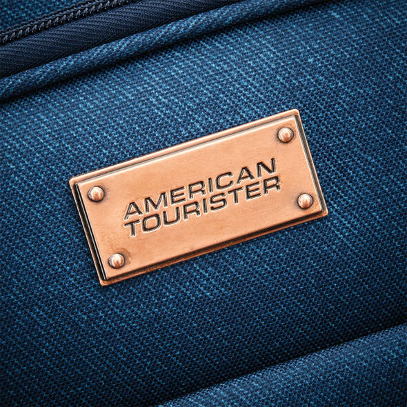 "American Tourister Belle Voyage 21"" Spinner in the color Blue Denim."