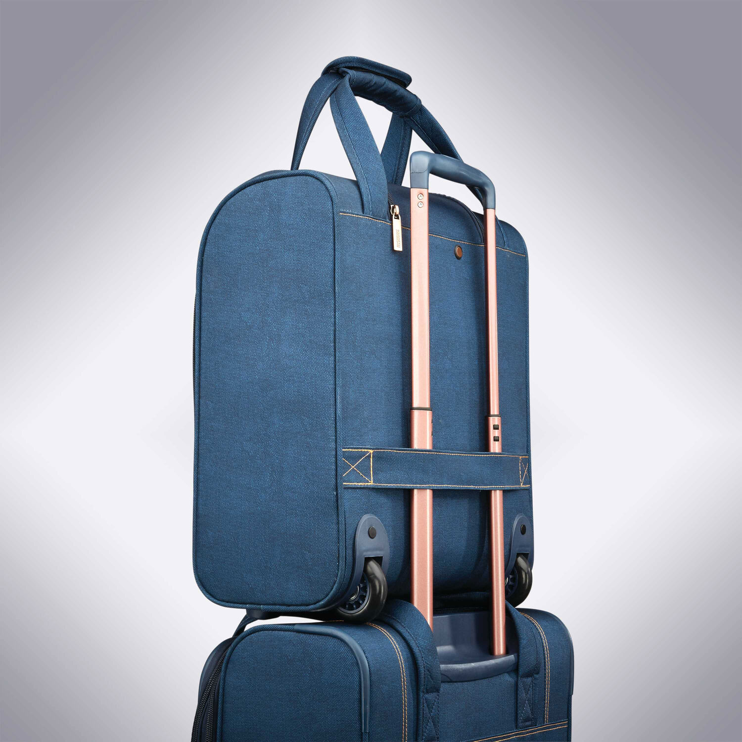 43cee85316 American Tourister Belle Voyage Rolling Tote in the color Blue Denim.