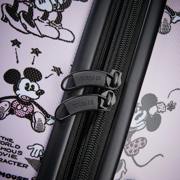 "American Tourister Disney Mickey & Minnie Romance 28"" Spinner in the color Mickey/Minnie Kiss."