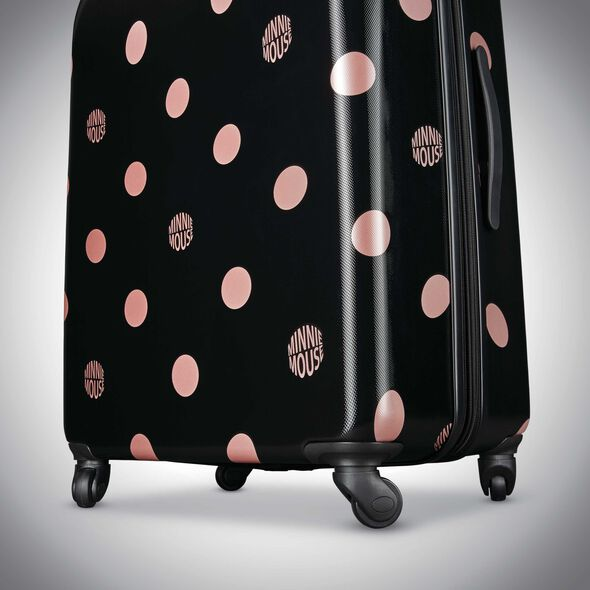 "American Tourister Disney Minnie Lux Dots 21"" Spinner in the color Black Dots."