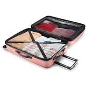 """American Tourister Moonlight 24"""" Spinner in the color Rose Gold."""