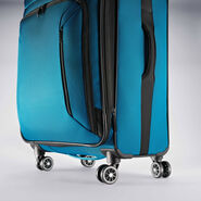 "American Tourister Zoom 25"" Spinner in the color Teal Blue."