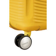 """American Tourister Curio 25"""" Spinner in the color Golden Yellow."""