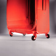 """American Tourister iLite Max 21"""" Spinner in the color Tangerine."""