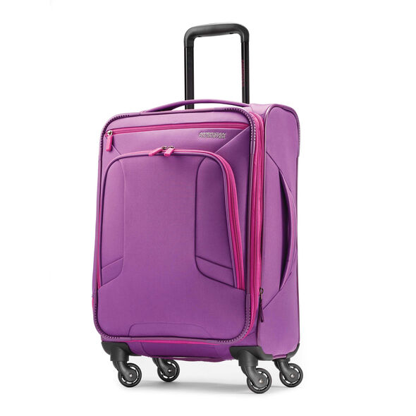 "American Tourister 4 Kix 21"" Spinner in the color Purple/Pink."