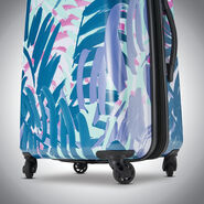 """American Tourister Moonlight 21"""" Spinner in the color Palm Trees."""