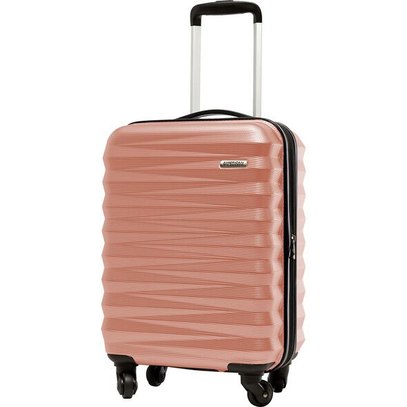"American Tourister Triumph NX 20"" Spinner in the color Rose Gold."