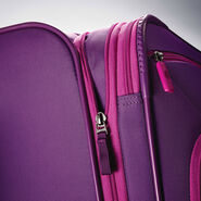 "American Tourister 4 Kix 25"" Spinner in the color Purple/Pink."