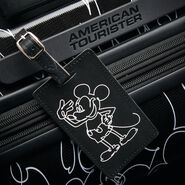 "American Tourister Disney Mickey Scribble 20"" Spinner in the color Mickey Mouse Multi Face."