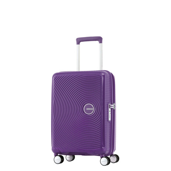 "American Tourister Curio 20"" Spinner in the color Purple."