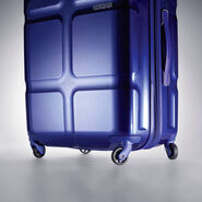 "American Tourister Cube Pop 20"" Spinner in the color Blue."