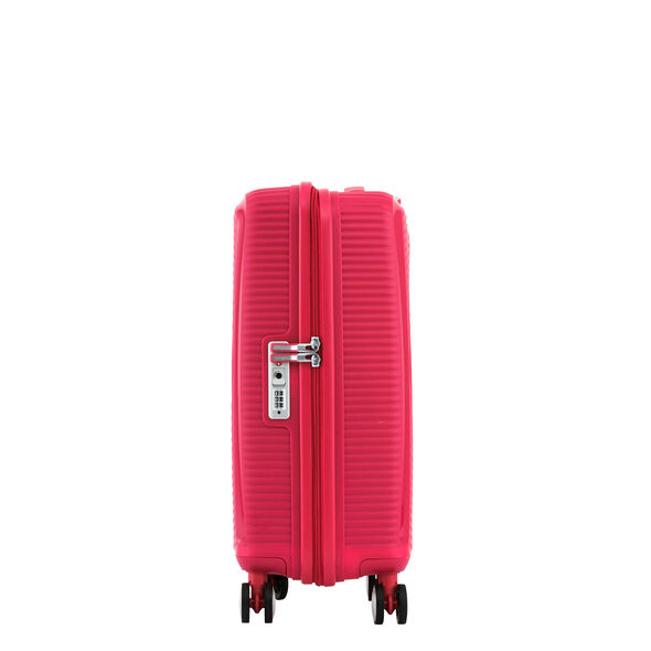 """American Tourister Curio 20"""" Spinner in the color Pink."""