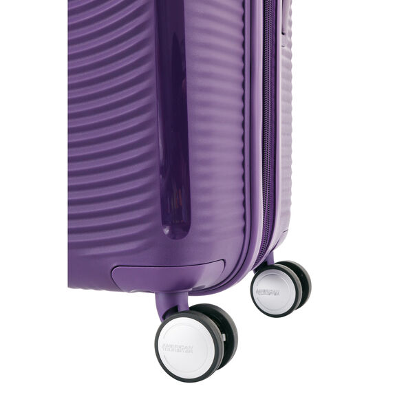 """American Tourister Curio 20"""" Spinner in the color Purple."""