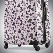 """American Tourister Disney Mickey & Minnie 28"""" Spinner in the color Minnie Loves Mickey."""