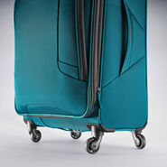 "American Tourister 4 Kix 21"" Spinner in the color Teal/Grey."