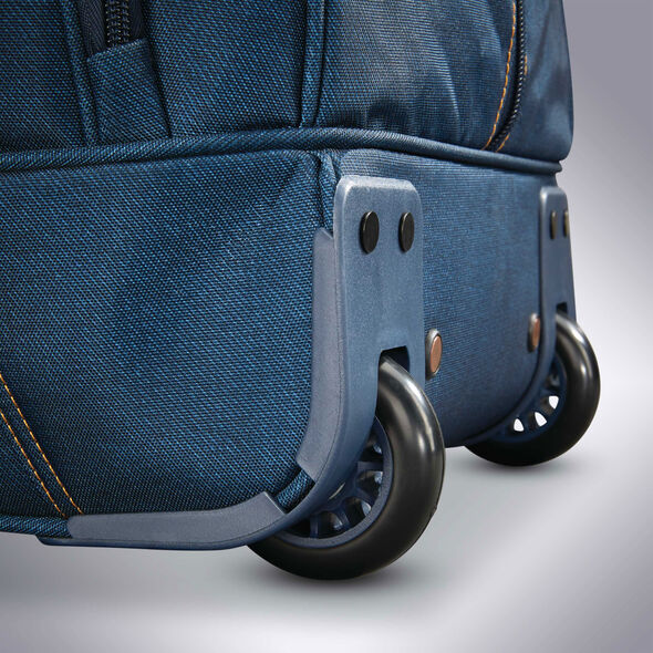 """American Tourister Belle Voyage 20"""" Wheeled Duffel in the color Blue Denim."""