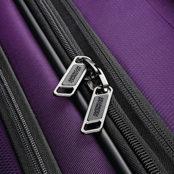 """American Tourister Zoom 25"""" Spinner in the color Purple."""